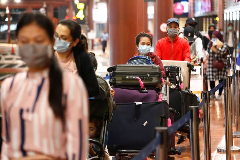 Passengers stand in line to have documents checked at a Soekarno Hatta Airport amid the coronavirus disease (COVID-19) outbreak in Jakarta