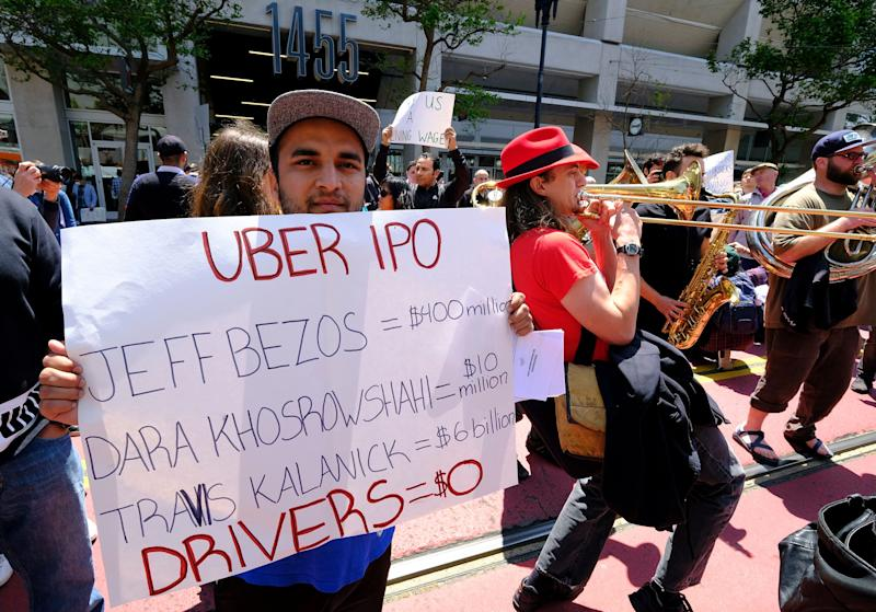Protesters hold a rally and stop traffic on Market Street outside of Uber headquarters Wednesday, May 8, 2019, in San Francisco. (AP Photo/Eric Risberg)