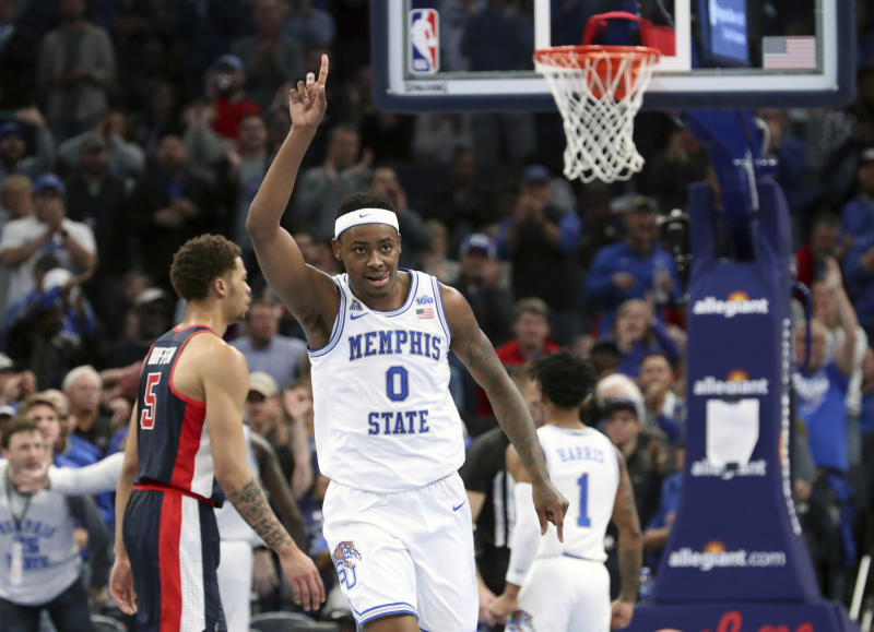 Memphis' D. J. Jeffries (0) reacts after dunking a basket in the first half of an NCAA college basketball game against Mississippi, Saturday, Nov. 23, 2019, in Memphis, Tenn. (AP Photo/Karen Pulfer Focht)
