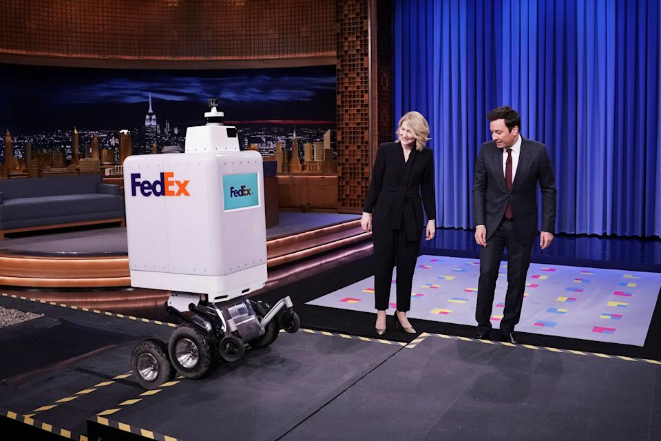 """THE TONIGHT SHOW STARRING JIMMY FALLON -- Episode 1023 -- Pictured: (l-r) A FedEx delivery Robot, FedEx representative Bree Carere, and host Jimmy Fallon during """"Tonight Showbotics"""" on February 26, 2019 -- (Photo by: Andrew Lipovsky/NBC/NBCU Photo Bank via Getty Images)"""