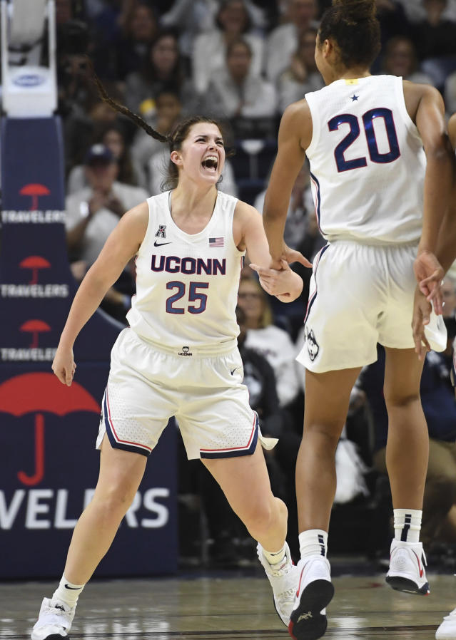 Connecticut's Kyla Irwin (25) and Connecticut's Olivia Nelson-Ododa (20) celebrate in the first half of an NCAA college basketball game against Notre Dame, Sunday, Dec. 8, 2019, in Storrs, Conn. (AP Photo/Jessica Hill)