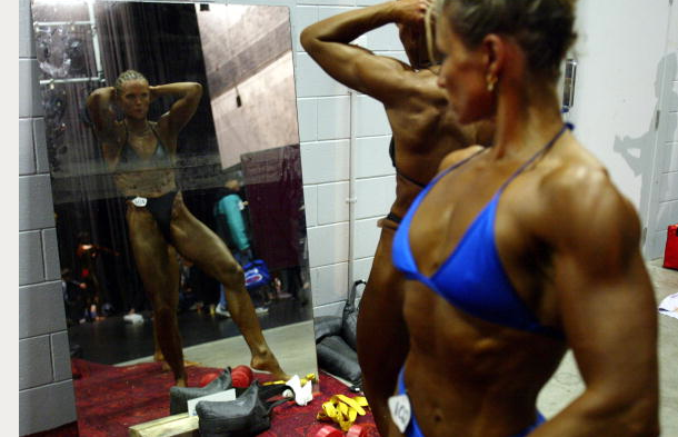 "<div class=""caption-credit""> Photo by: Michael Bradley/Getty Images</div>After thousands of hours at the gym and meticulously crafted nutrition plans, the final step for female bodybuilders poised for competition is product. Lots of it. Popular standards of beauty vary by era, geography, and culture, but in the world of women's muscle mass, there's one hard and fast rule."