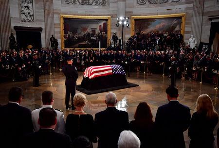 Mourners surround the casket of former Senator John McCain in the Capitol Rotunda where he will lie in state at the U.S. Capitol, in Washington, DC on Friday, August 31, 2018. McCain, an Arizona Republican, presidential candidate and war hero died August 25th at the age of 81. He is the 31st person to lie in state at the Capitol in 166 years.  Kevin Dietsch/POOL Via REUTERS