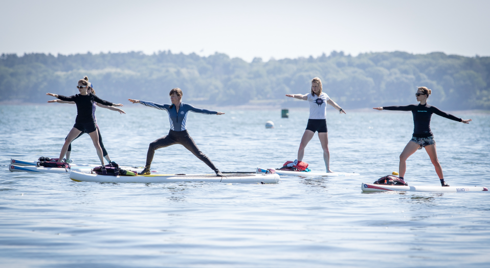 A standup paddle board yoga class off of the East End Beach in Portland, Maine. (Staff Photo by Joel Page/Portland Press Herald via Getty Images)