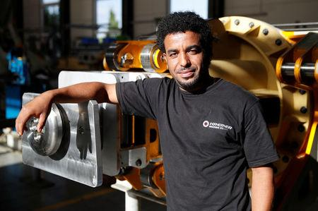 Eritrea immigrant Tesfay pictured at plant engineering firm Kremer Machine Systems in Gescher