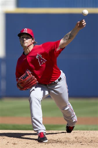 Los Angeles Angels' C.J. Wilson warms up for a spring training baseball game against the Milwaukee Brewers on Saturday, March 2, 2013, in Phoenix. (AP Photo/Morry Gash)