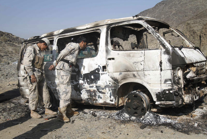 Afghan border policemen check inside of a burnt out deminers' vehicle in Nangarhar, east of Kabul, Afghanistan, Wednesday, Dec. 1, 2010. Taliban militants seized 16 Afghan demining experts in an ambush near the Pakistan border Wednesday and released all but seven of them hours after the attack, officials said. (AP Photo/Rahmat Gul)