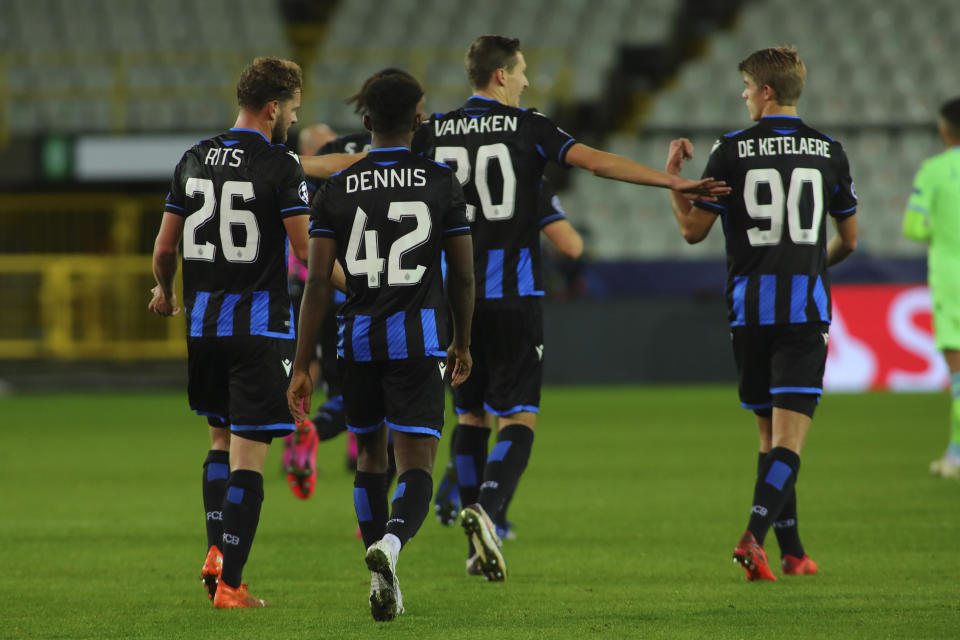 Brugge's Hans Vanaken, center, celebrates with teammates after scoring his side's first goal during the Champions League Group F soccer match between Brugge and Lazio at the Jan Breydel stadium in Bruges, Belgium, Wednesday, Oct. 28, 2020. Vanaken scored an equaliser goal and the match ended in a 1-1 draw. (AP Photo/ Olivier Matthys)