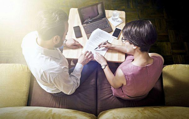 PHOTO: A man and woman pose reading papers in an undated stock image. (STOCK IMAGE Svetazi/Shutterstock)