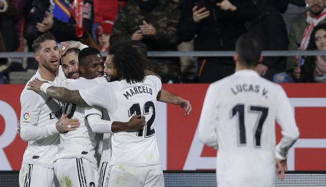 Real Madrid's Benzema, second left, celebrates with teammates after scoring during a Spanish Copa del Rey soccer match between Girona and Real Madrid at the Montilivi stadium in Girona, Spain, Thursday, Jan. 31, 2019. (AP Photo/Manu Fernandez)