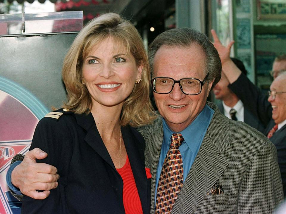 King poses with Shawn Southwick in 1997 at the unveiling of his star on the Hollywood Walk of FameReuters