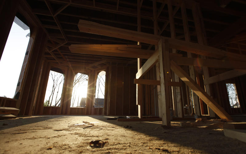 In a Friday, March 23, 2012 photo, sun streams through window cutouts in an unfinished home in Richmond, Va. Sales of new homes fell in March 2012 by the largest amount in more than a year, indicating that the U.S. housing market remains under strain despite some modest signs of improvement.  (AP Photo/Steve Helber)