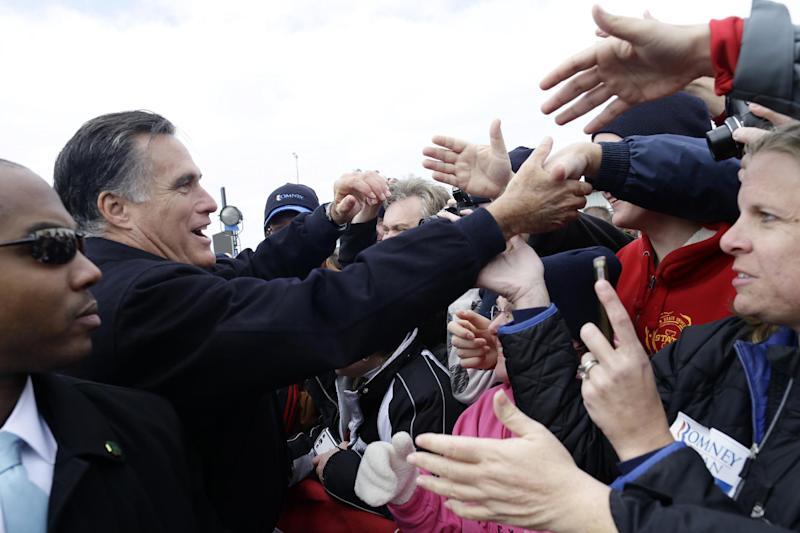 Republican presidential candidate, former Massachusetts Gov. Mitt Romney greets supporters after he spoke about the economy at a campaign rally at Kinzler Construction Services in Ames, Iowa, Friday, Oct. 26, 2012. (AP Photo/Charles Dharapak)