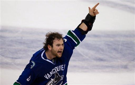 Vancouver Canucks' Zack Kassian celebrates after fighting Edmonton Oilers' Ben Eager, not pictured, during the third period of an NHL hockey game in Vancouver, British Columbia, on Sunday Jan. 20, 2013. (AP Photo/The Canadian Press, Darryl Dyck)