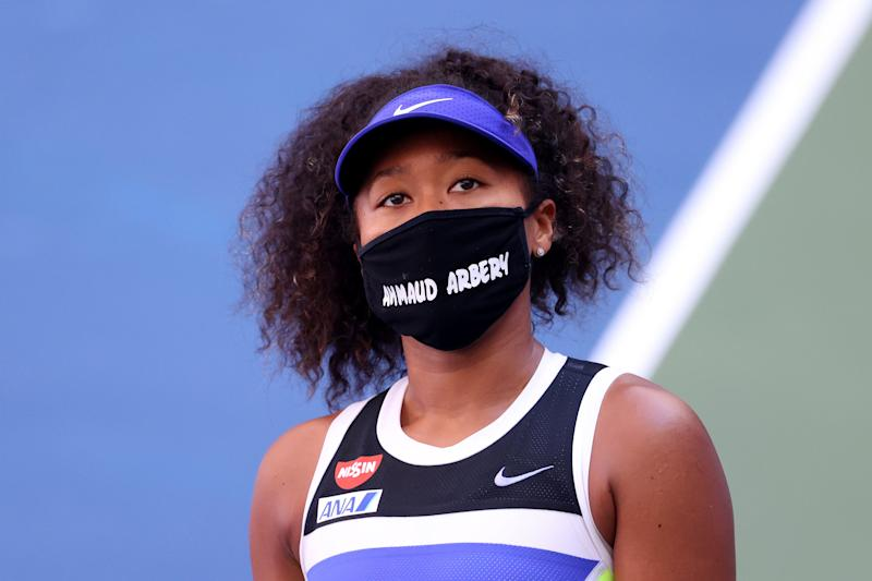 Naomi Osaka of Japan wears a protective face mask with the name, Ahmaud Arbery stenciled on it at the 2020 U.S. Open at USTA Billie Jean King National Tennis Center on September 04, 2020 in New York City. Ahmaud Arbery, an unarmed 25-year-old African-American man, was pursued and fatally shot while jogging in Glynn County, Georgia.