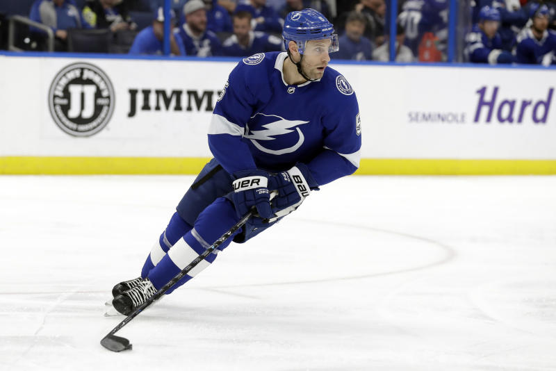 FILE - In this Jan. 17, 2019, file photo, Tampa Bay Lightning defenseman Dan Girardi skates with the puck during the first period of an NHL hockey game against the Toronto Maple Leafs in Tampa, Fla. The former New York Rangers and Tampa Bay Lightning defenseman has announced his retirement from the NHL after 13 seasons on Friday, Sept. 20, 2019.  (AP Photo/Chris O'Meara, File)