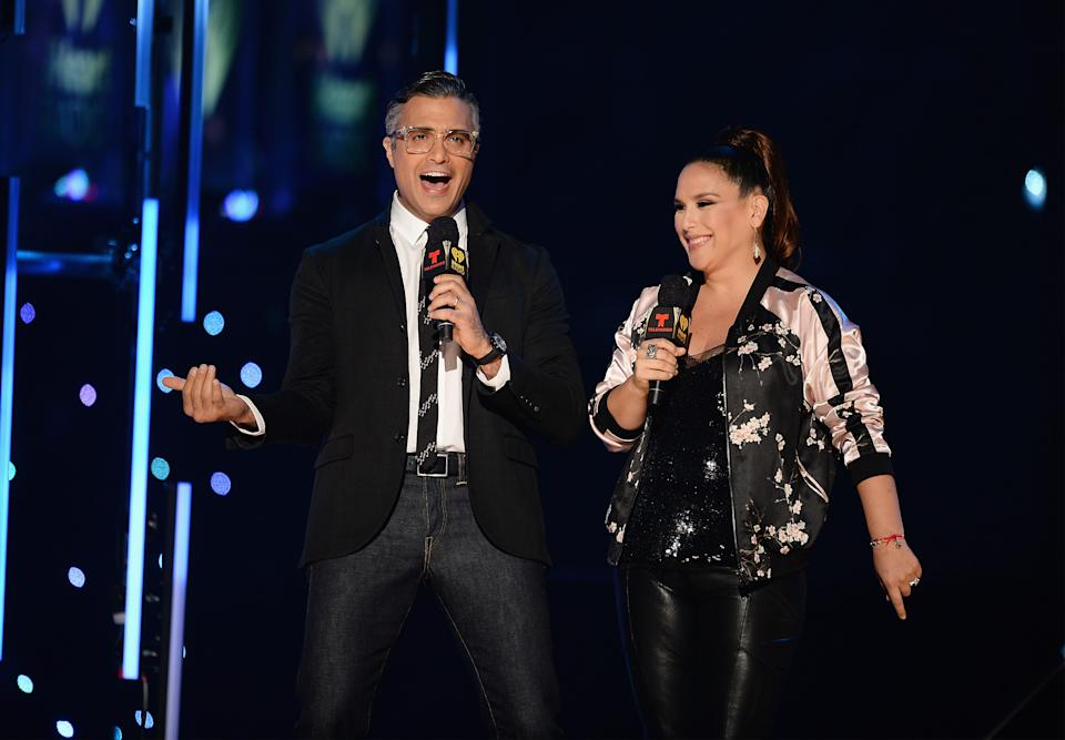 MIAMI, FL - NOVEMBER 05:  Jaime Camil and Angelica Vale speak on stage at iHeartRadio Fiesta Latina at American Airlines Arena on November 5, 2016 in Miami, Florida.  (Photo by Jason Koerner/Getty Images for iHeartMedia)