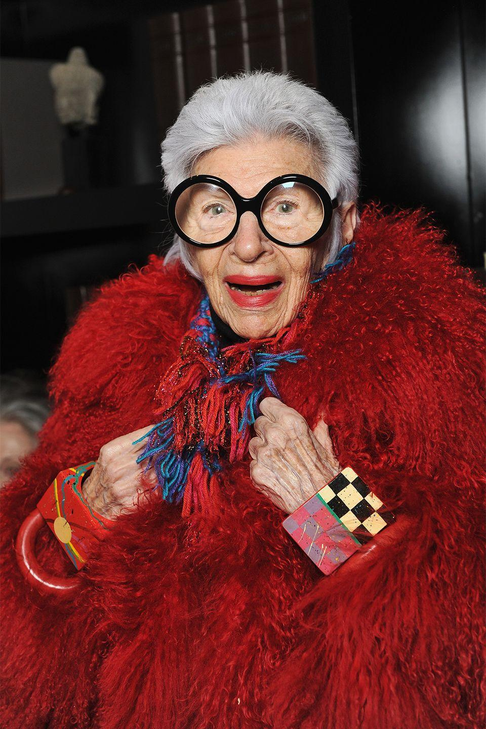 """<p>Go bold or go home as one of fashion's most recognizable faces. All you need are some round oversized glasses and an overload of statement jewelry, and you're ready to do Iris Apfel proud. </p><p><strong>Get the look: Valentino</strong> hexagon-frame acetate and gold-tone optical glasses, $361, <a href=""""https://click.linksynergy.com/deeplink?id=6Km1lFswsiY&mid=24449&murl=https%3A%2F%2Fwww.net-a-porter.com%2Fen-us%2Fshop%2Fproduct%2Fvalentino%2Faccessories%2Fglasses%2Fvalentino-garavani-hexagon-frame-acetate-and-gold-tone-optical-glasses%2F9649229528848827"""" rel=""""nofollow noopener"""" target=""""_blank"""" data-ylk=""""slk:net-a-porter.com"""" class=""""link rapid-noclick-resp"""">net-a-porter.com</a>. </p><p><a class=""""link rapid-noclick-resp"""" href=""""https://click.linksynergy.com/deeplink?id=6Km1lFswsiY&mid=24449&murl=https%3A%2F%2Fwww.net-a-porter.com%2Fen-us%2Fshop%2Fproduct%2Fvalentino%2Faccessories%2Fglasses%2Fvalentino-garavani-hexagon-frame-acetate-and-gold-tone-optical-glasses%2F9649229528848827"""" rel=""""nofollow noopener"""" target=""""_blank"""" data-ylk=""""slk:SHOP"""">SHOP</a>  </p>"""