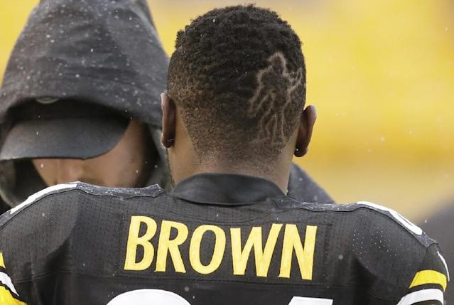 Pittsburgh Steelers wide receiver Antonio Brown walks along the sidelines with a figure cut into this hair before an NFL football game Cleveland Browns, Sunday, Dec. 29, 2013, in Pittsburgh. (AP Photo/Gene J. Puskar)