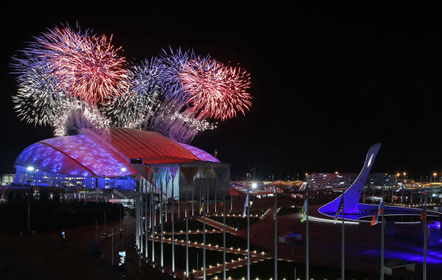 Fireworks are seen over Olympic Park during the opening ceremony of the 2014 Winter Olympics in Sochi, Russia, Friday, Feb. 7, 2014. (AP Photo/Julio Cortez)