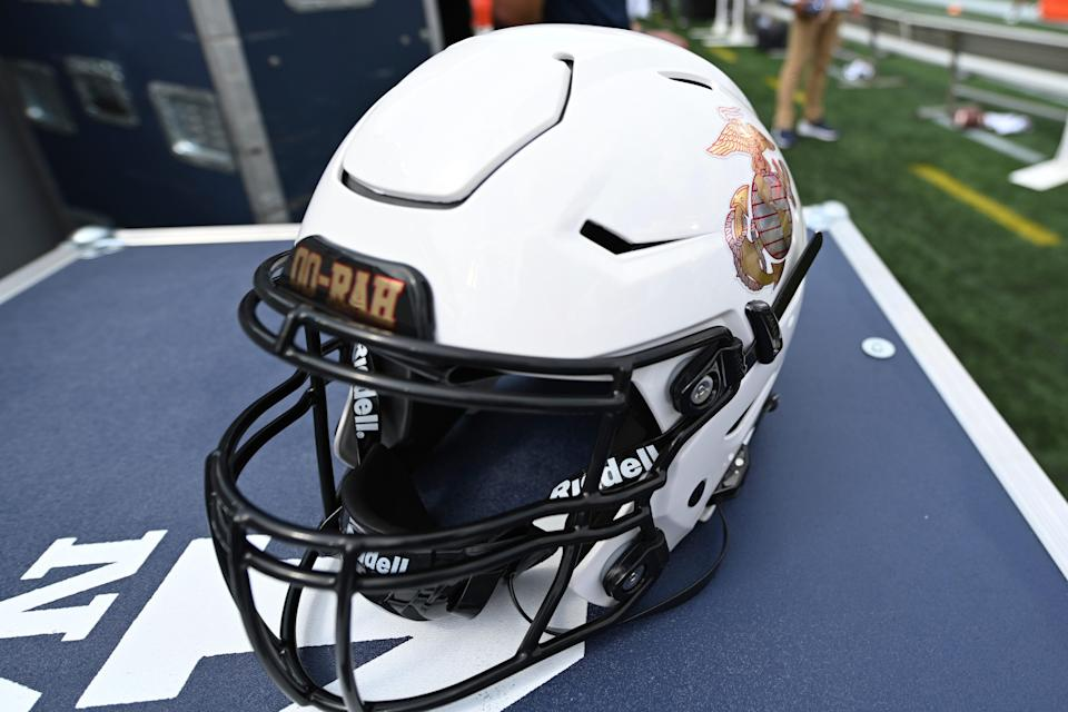 A Navy football helmet with a Semper Fi logo sits on the sideline before an NCAA college football game against Air Force, Saturday, Sept. 11, 2021.