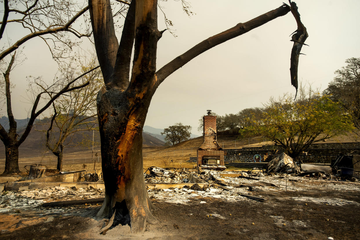 A chimney is all that's left of a home leveled by the Kincade fire in Calistoga, Calif. (Photo: Noah Berger/AP)