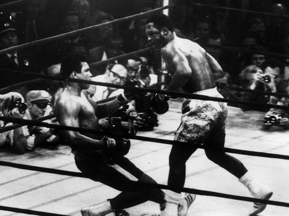 Joe Frazier knocks down Muhammad Ali in their meeting in March 1971 (Getty Images)