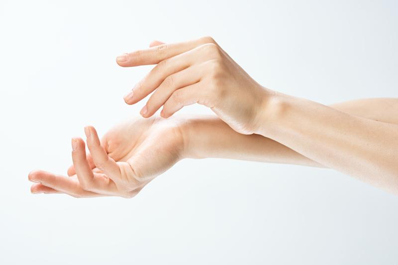 Female hands on a white isolated background