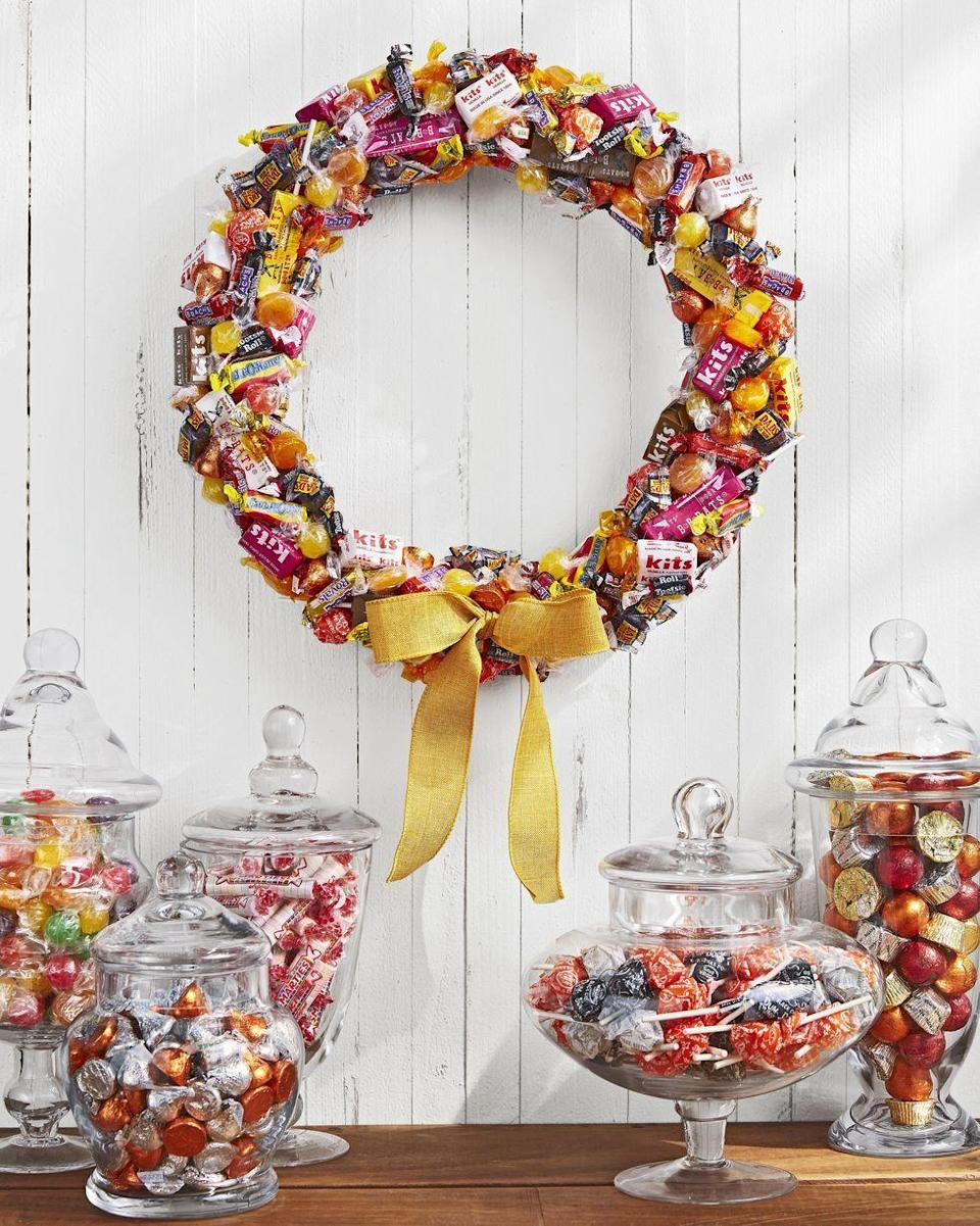 <p>If you prefer to focus on the sweetness that the holiday brings, deck out your door with a wreath made out of assorted candies in autumnal hues. Just keep a few extra candies on hand to make the crafting experience sugary-sweet.</p>