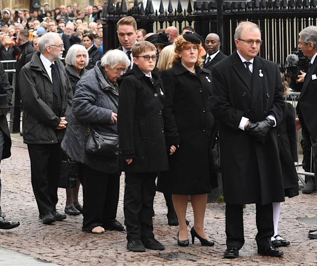 <p>Relatives and family members wait as the coffin of Professor Stephen Hawking is lifted from the hearse outside University Church of St Mary the Great in Cambridge for his funeral service in England on March 31, 2018. (Photo: Joe Giddens/PA Wire via ZUMA Press) </p>