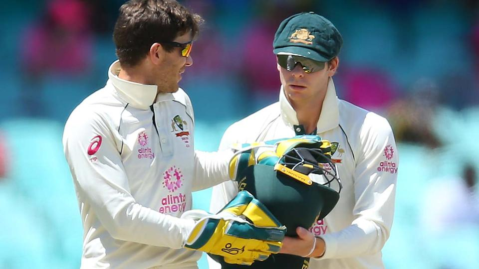 Tim Paine and Steve Smith, pictured here during the third Test between Australia and India.