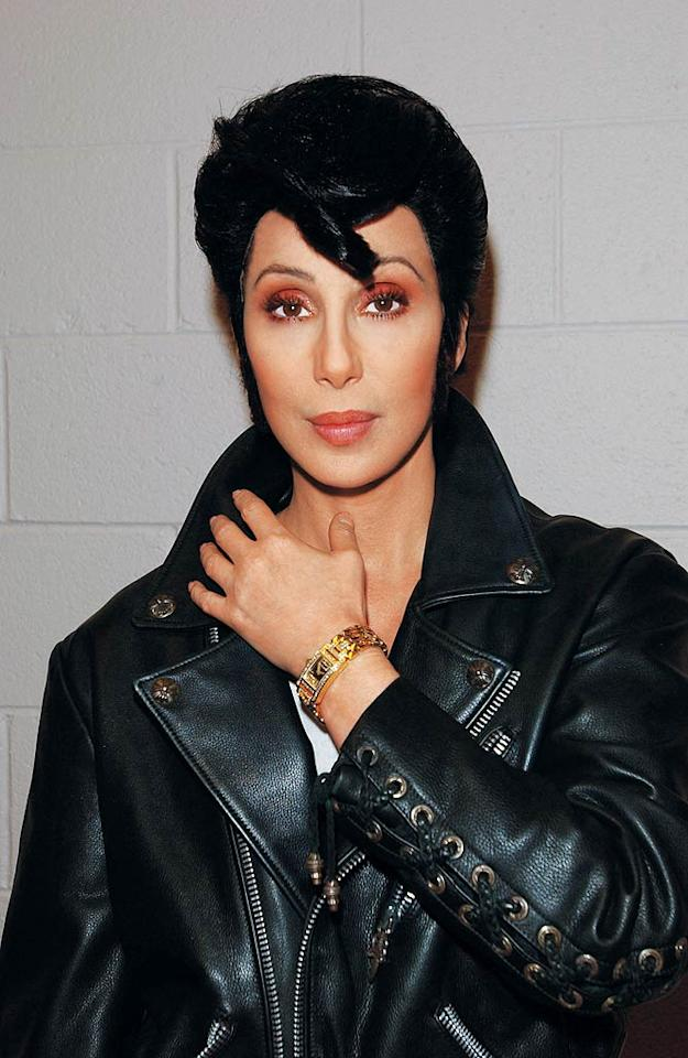"""<b>2002:</b> """"In my first TV special I played all the parts in 'West Side Story'; this was Bernardo's wig. We just changed him into Elvis,"""" says Cher, who surprised her co-stars Mary J. Blige, Celine Dion, and others at the VH1 Divas Las Vegas concert in an Elvis coif during a Presley tribute.   <a href=""""http://www.instyle.com/instyle/package/general/photos/0,,20396039_20436052_20866423,00.html?xid=omg-cher-sexy-jeans?yahoo=yes"""" target=""""new"""">InStyle Picks the Sexiest Jeans Ever</a> Frank Micelotta/ImageDirect/<a href=""""http://www.gettyimages.com/"""" target=""""new"""">GettyImages.com</a> - May 23, 2002"""
