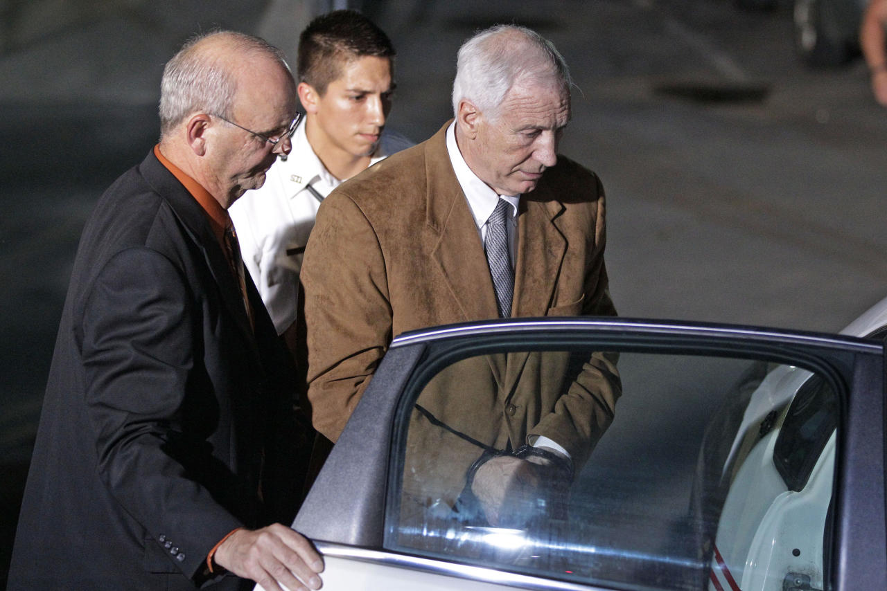 Former Penn State University assistant football coach Jerry Sandusky, right, is escorted by Centre County Sheriff Denny Nau, left, as he is taken into custody at the Centre County Courthouse after being found guilty of multiple charges of child sexual abuse in Bellefonte, Pa., Friday, June 22, 2012. Sandusky was convicted of sexually assaulting 10 boys over 15 years on Friday, accusations that had sent shock waves through the college campus known as Happy Valley and led to the firing of Penn State's beloved Hall of Fame coach, Joe Paterno. (AP Photo/Gene J. Puskar)