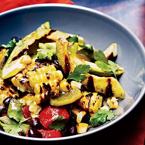 """<p>Here's a great side for grilled meats and fish. Be sure you don't skimp on the fresh cilantro. It brings an extra dash of fresh flavor.</p> <p> <a rel=""""nofollow noopener"""" href=""""http://www.myrecipes.com/recipe/corn-poblano-black-bean-salad"""" target=""""_blank"""" data-ylk=""""slk:View Recipe: Grilled Corn, Poblano, and Black Bean Salad"""" class=""""link rapid-noclick-resp"""">View Recipe: Grilled Corn, Poblano, and Black Bean Salad</a></p>"""