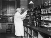 <p>A pharmacist mixes a medicinal concoction at a hospital in London.</p>