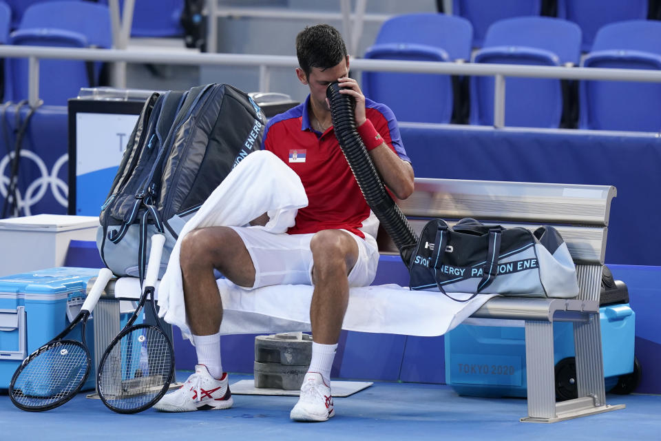 Novak Djokovic, of Serbia, cools off during a third round men's tennis match against Alejandro Davidovich Fokina, of Spain, at the 2020 Summer Olympics, Wednesday, July 28, 2021, in Tokyo, Japan. (AP Photo/Patrick Semansky)