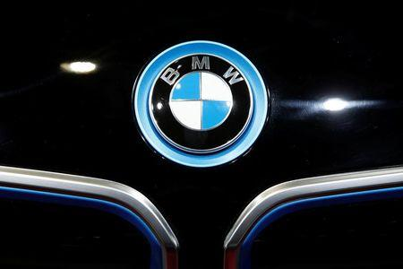 A BMW logo is seen on media day at the Paris auto show, in Paris
