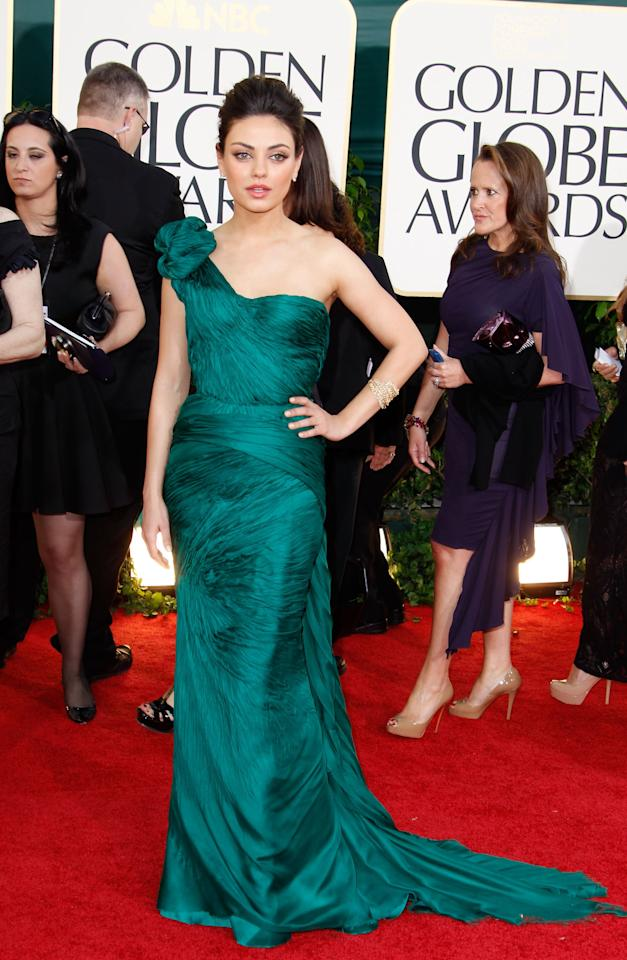 <p>Mila Kunis arrives at the 68th Annual Golden Globe Awards in 2011.</p>