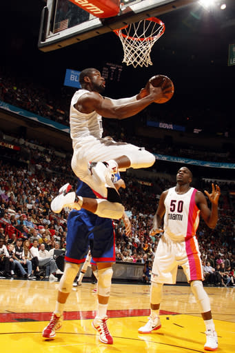 MIAMI, FL - MARCH 6: Dwyane Wade #3 of the Miami Heat goes to the basket against the New Jersey Nets on March 6, 2012 at American Airlines Arena in Miami, Florida. (Photo by Issac Baldizon/NBAE via Getty Images)