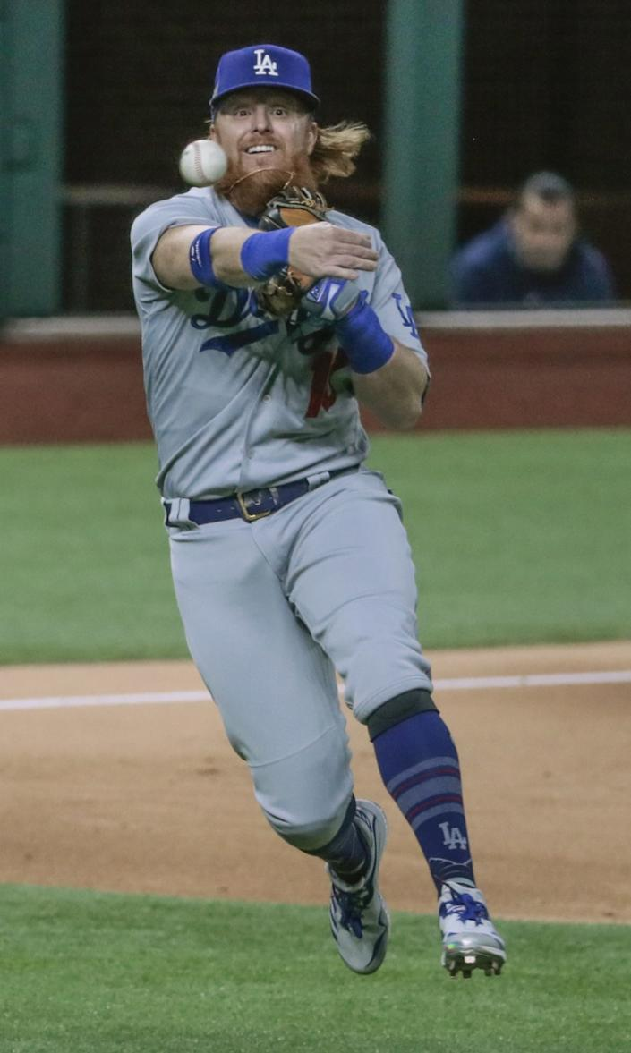 Dodgers third baseman Justin Turner makes a throw during Game 4 of the NLCS.