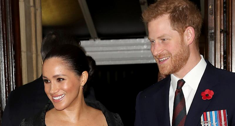 Meghan Markle and Prince Harry smile as they attend a royal event
