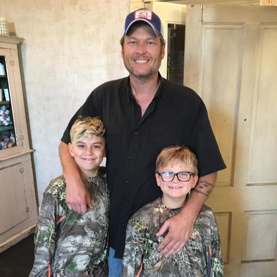 """<p>Shelton posed for a photo with Kington and Zuma, with the two boys <a href=""""https://www.instagram.com/p/CBtEbMcjot0/"""" rel=""""nofollow noopener"""" target=""""_blank"""" data-ylk=""""slk:wearing matching camo shirts"""" class=""""link rapid-noclick-resp"""">wearing matching camo shirts</a>. </p>"""