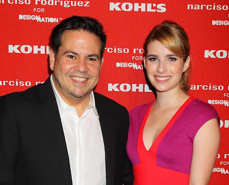 """FILE - This Oct. 22, 2012 file photo released by Starpix shows fashion designer Narciso Roriguez, left, with actress Emma Roberts at the Narciso Rodriguez for DesigNation launch in partnership with Kohl's department store in New York. Rodriguez has joined the likes of Jason Wu and Missoni by launching a limited-edition collection with a more affordable national retailer. Roberts said she appreciates the accessibility of the collection for Kohl's. """"I love when these big designers are collaborating with places to make their stuff more accessible to everybody and also just making kind of more everyday pieces because so many of these designers I love, but they do these gowns that you can't exactly wear to the supermarket."""" (AP Photo/Starpix, Dave Allocca)"""
