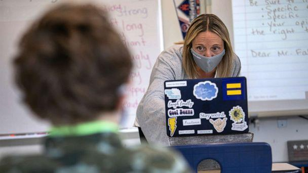 PHOTO: Third grade teacher Cara Denison speaks to students while live streaming her class at Rogers International School on Nov. 19, 2020, in Stamford, Conn. (John Moore/Getty Images, FILE)