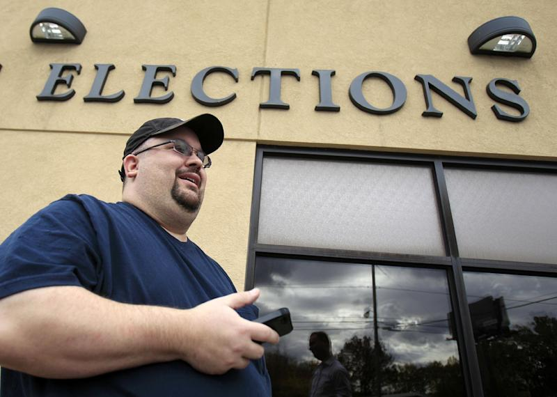 This photo taken Oct. 19, 2012 shows a President Barack Obama supporter Brian Axiotis, who works in information technology, discussing politics after voting at the Trumbull County Board of Elections, in Warren, Ohio. President Barack Obama's decision to help America's automakers could end up being what helps drive him back into the White House. Some 850,000 jobs in this critical battleground state are tied to autos and Obama's campaign constantly reminds voters they'd be jobless if not for the decision to inject taxpayer dollars into General Motors and Chrysler. (AP Photo/Tony Dejak)
