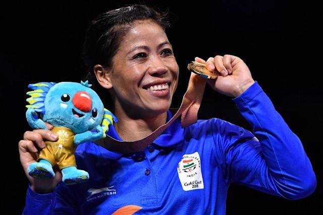 Mary Kom was one of three Indian boxing gold-medallists at the Commonwealth Games. (AFP Photo/Anthony WALLACE)