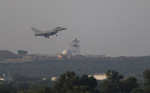 A fighter jet prepares to land at RAF Akrotiri, a military base Britain maintains on Cyprus - Credit: Reuters
