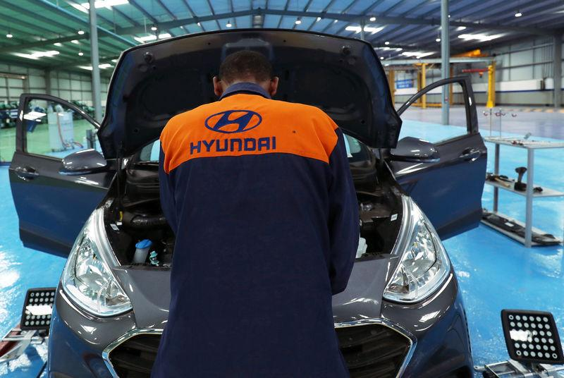 An employee assembles a Hyundai car in Hyundai Marathon Motor assembly plant on the outskirt of Addis Ababa