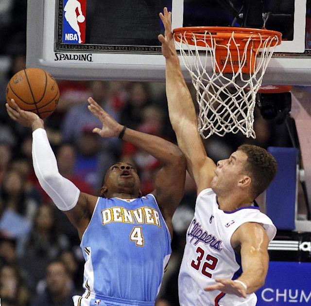 Denver Nuggets guard Randy Foye (4) shoots with Los Angeles Clippers forward Blake Griffin (32) defending during the first half of an NBA basketball game in Los Angeles on Saturday, Dec. 21, 2013. (AP Photo/Alex Gallardo)