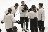 "FILE - In this July 14, 2020, file photo, Boston Bruins captain Zdeno Chara, second from left, talks with teammates including Brad Marchand, center, at the NHL hockey team's camp in Boston. Others are David Krejci, far left , Torey Krug, far right, and Patrice Bergeron, second from right. Brad Marchand saw enough as Zdeno Chara's teammate to know how to approach the Capitals defensemen when they are in opposite uniforms: ""Don't poke the bear."" (AP Photo/Charles Krupa. File)"